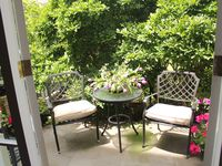 Juliette Balcony with bench seat and shade umbrella