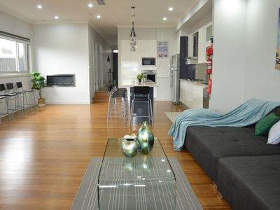 spacious lounge dinning room with gas heater