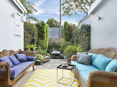 Sun soaked private & tranquil rear courtyard