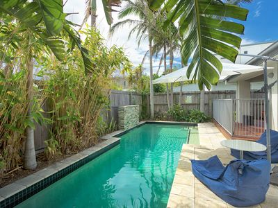 Tropical solar heated swimming pool