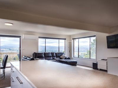 Enjoy the open plan living with spectacular views over the river and city