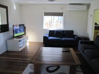 Lounge with comfy lounges and flat screen TV