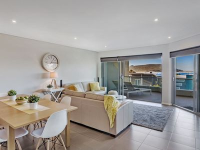 Open plan living leading out to an expansive balcony with Fingal Bay views