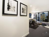 Entrance into the apartment that open up into the open plan living area