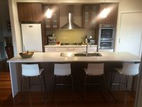 Fully fitted kitchen with coffee machine