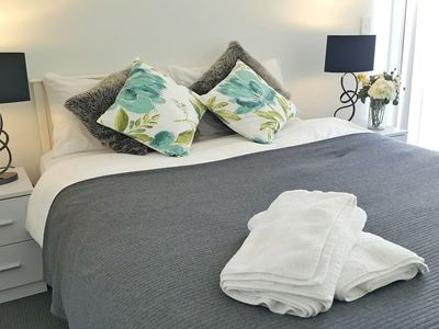 Bedroom 1 with queen size bed/build in wardrobe access to open and large balcony