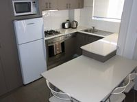 kitchen for self catering all apartments: Parramatta View Furnished Apartments