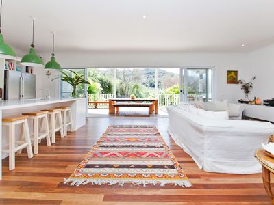 Living room/kitchen opens to large covered deck overlooking backyard