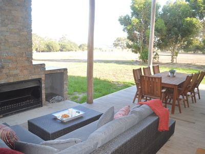 Outdoor fireplace and rural views