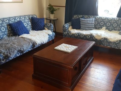 Lounge room with gorgeous country click clack couches
