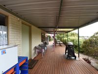 Back deck with barbecue and outdoor setting;additional fridge and washup area