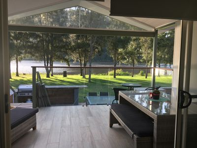 Spacious deck overlooking BBQ area and river