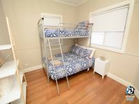 Second bedroom with double bed on bottom and single on top.