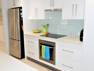 Kitchen - SS Fridge/Freezer, Electric FF Oven, Glass Cooktop & Coffee Machine.