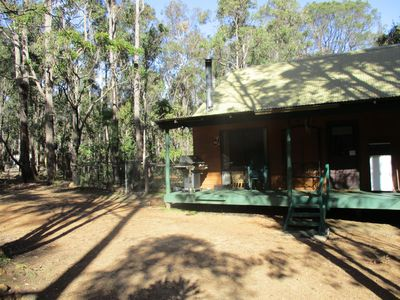 chalet 3, nestled in the bush, with the dog run on the side