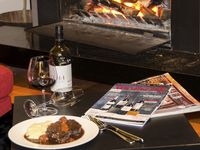 Enjoy a slow-cooked beef cheek with wine by the fireplace in winter