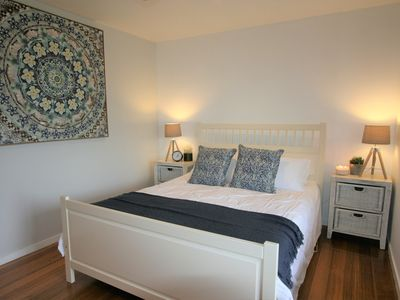 Ground floor spacious queen bedroom with blackout blinds off main living space
