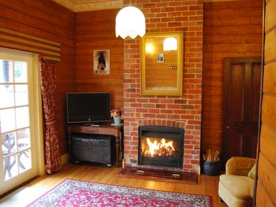 Formal Lounge with TV and open wood fire.