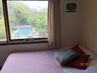 2nd upstairs bedroom with double bed, desk overlooking pool