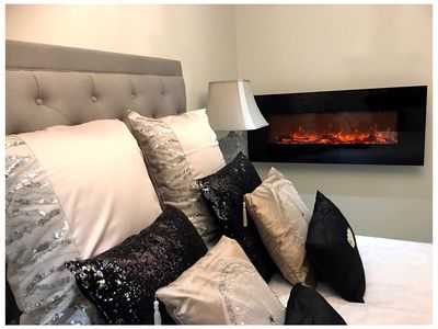 """Master Bedroom with 55"""" LED Smart TV with Netflix and Electric Fireplace"""