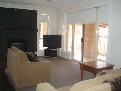 Loungeroom with Free Foxtel and gas log burning heater