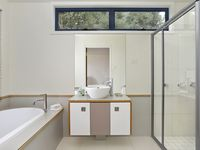 The generous bathroom has a large shower and bath with complimentry toiletries
