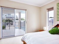 Bedroom 3 with Queen bed & access to pool