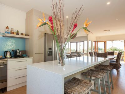 Open plan chefs kitchen with view to garden and bay