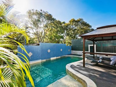 Sparkling in ground salt water pool with your own private under over cabana