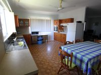 Large full-equipped kitchen and dining area.