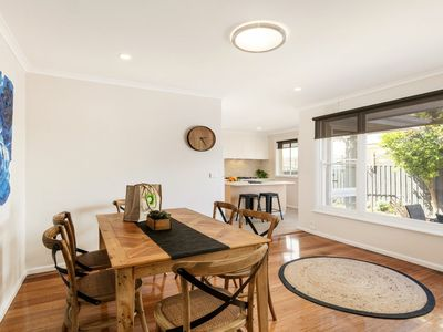 Spacious dining room highlighted by polished boards