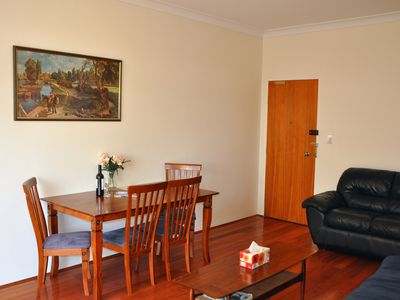 Living Room with lounge suite, double sofa bed, dining suite and coffee table