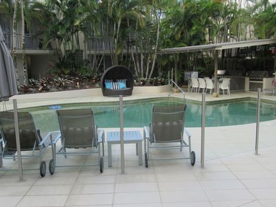 Pool area with BBQ's
