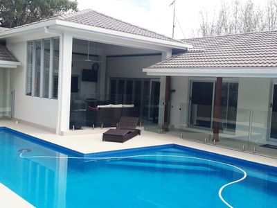 Across pool to alfresco area