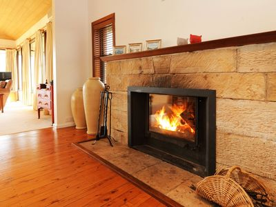 Huge fire place with wood supplied