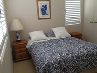 Master bedroom has a comfy queen bed and ensuite