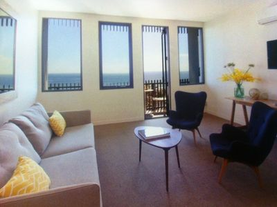 Open plan living with access to balcony 180 bay views