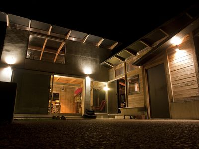 The exterior of view of The Hut at night