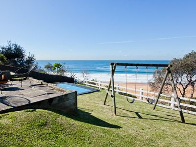 Absolute beach frontage & sweeping ocean views