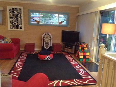Open lounge with Foxtel, jukebox, record player and movies