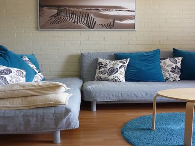 Comfortable lounge area with two futons which fold down to 2 double beds.