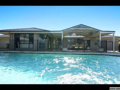 SPARKLING OUTDOOR POOL AND UNDERCOVER PATIO AREA