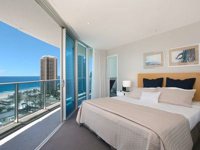 main bedroom with ocean views and wrap around balcony-Flat screen TV with FOXTEL
