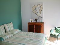 Second Bedroom with double bed and access to private deck