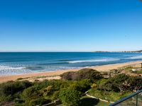 Absolute beach front with full length balcony - stunning views!