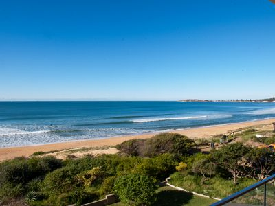 Absolute beach front with full length balcony - stunning views