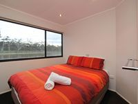 The four bedrooms can be made as queen or split to two singles
