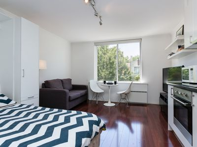 Light and Bright: Modern sleek studio apartment with comfy couch and queen bed