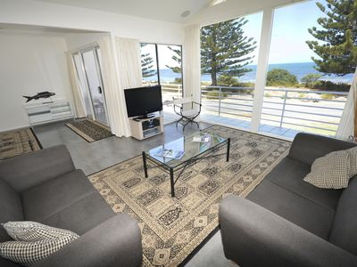 Spacious living and dining area with panoramic sea views
