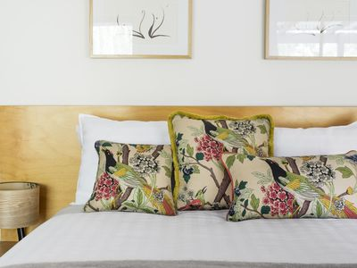 Luxury linen and curated textiles and artwork.